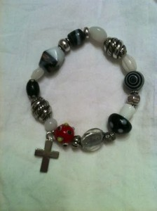 "8"" long bracelet with cross charm.   $16.50 which includes shipping"